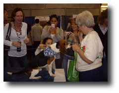 Linda Forrest (right) at Meet the Breeds 2010 shows an adoptable beagle